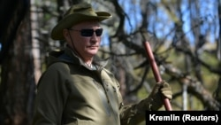 Russian President Vladimir Putin is seen during his holiday in the Siberian taiga on October 7.