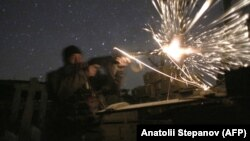 A Ukrainian soldier fires during fighting with pro-Russian separatists in Avdiyivka, near Donetsk.