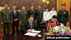 China - Chinese Defense Minister Chang Wanquan and his Armenian counterpart Vigen Sargsian sign an agreement in Beijing, 4Sep2017.