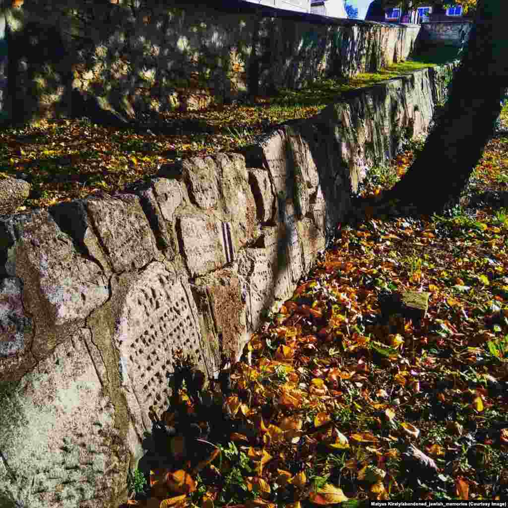 """A Jewish cemetery in Austria that was systematically destroyed by Nazis. After the war, Austrian locals built a memorial and walls from the broken tombstones, an act Kiraly describes as """"a beautiful repentance by the Austrian people."""""""