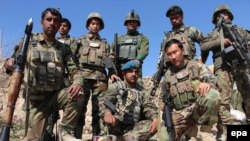 Afghanistan -- Afghan soldiers pose for a group photo during a patrol to take back the control of Baba Ji district from Taliban militants in Helmand province, February 14, 2016