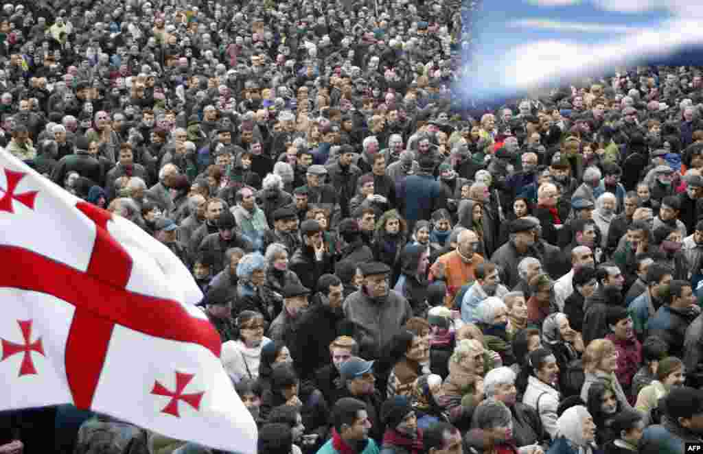 Georgian opposition protesters rally outside the Georgian parliament in Tbilisi on November 12. Several hundred protesters camped outside parliament for the fourth consecutive day as Shevardnadze signalled a tougher line on demonstrations calling for his resignation.