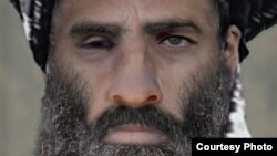 """""""Талибанның"""" 2013 жылы қаза тапқан деп жарияланған басшысы Мулла Мохаммад Омар."""