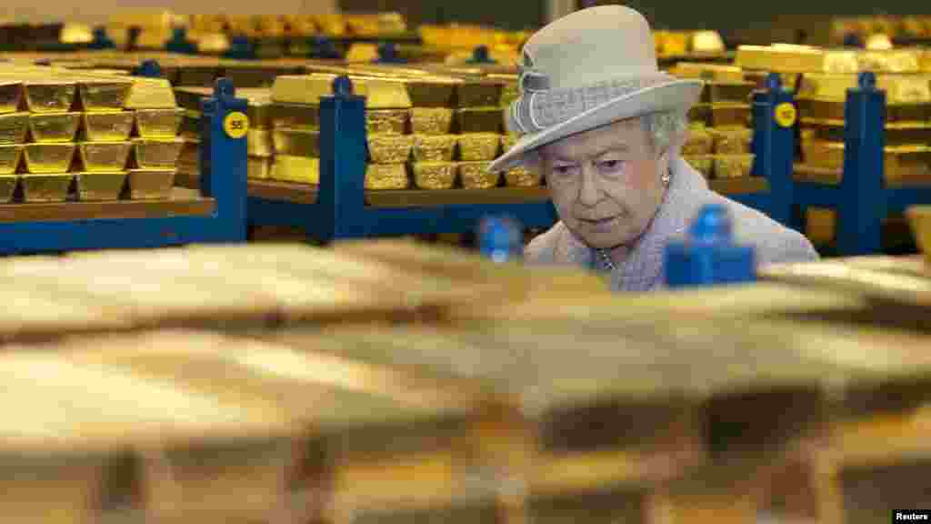 Britain's Queen Elizabeth tours a gold vault during a visit to the Bank of England in London's financial district. (Reuters/Eddie Mulholland)