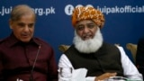 FILE: Pakistan's opposition leaders, Shehbaz Sharif (L) and Maulana Fazlur-Rehman during a meeting in Islamabad in July.