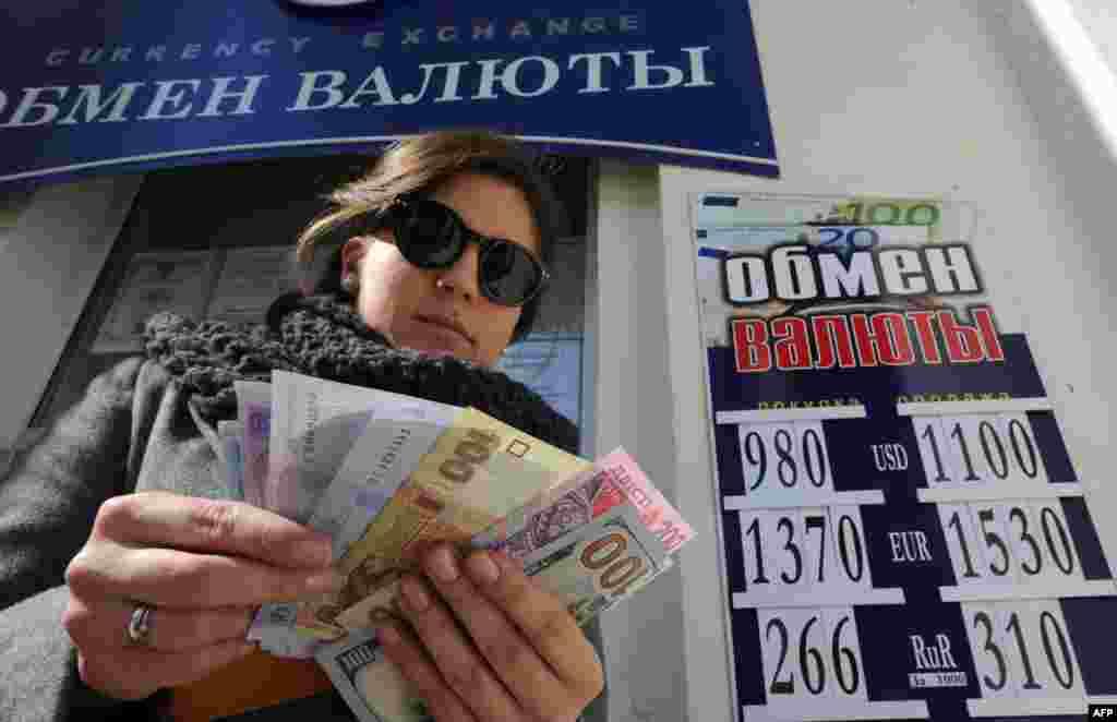 Крым в самое ближайшее время, как обещают его новые власти, готов отказаться от гривны и перейти на расчеты в рублях