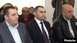 Armenia -- Mihran Keshishian (L) and other police officers attend the trial of opposition activist Samson Khachatrian, 19Apr2011.