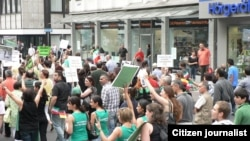 Iranians living in Germany protest against the reelection of Mahmud Ahmadinejad.