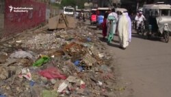 Garbage Piles Up In Pakistani Town As Collectors Strike