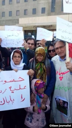 Leading Iranian rights activists Nasrin Sotoudeh (far left) and Mohammad Nourizad (far right) attend a rally in Tehran to protest recent spate of acid attacks on women.