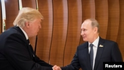 U.S. President Donald Trump (left) and Russian President Vladimir Putin at the G20 Summit in Hamburg on July 7.