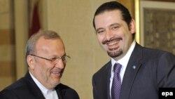 منوچهر متکی (چپ) به همراه سعد حریری، نخست وزیر جدید لبنان