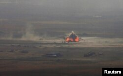 A car-bomb attack is seen to the east of Mosul during clashes with Islamic State militants on October 17.
