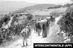 Refugiați palestinieni, în 1948.