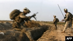 U.S. Marines battle Taliban militants northeast of Marjah in February.