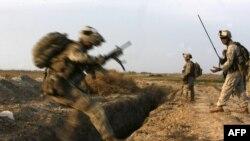 U.S. Marines battle Taliban militants northeast of Marjah in February.