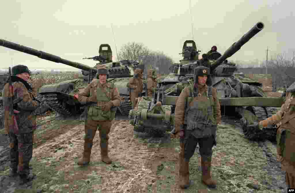 "Russian troops mass near Grozny. Fears that Chechnya's independence could lead to a ""domino effect"" and fragmentation of the newly formed Russian Federation led Moscow to try to retake Chechnya by force. A ground assault begins on December 11, 1994."
