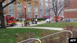 A photo from the student daily newspaper of Ohio State University, The Lantern, shows police securing an area on the campus in Columbia following reports that a shooter was on the loose.