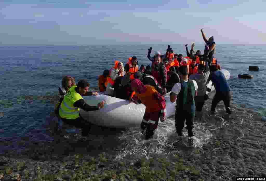 A migrant boat approaches the Greek island of Lesbos. In addition to the massing of people, Lesbos is trying to cope with the tide of inflatable boats on which the migrants arrive.