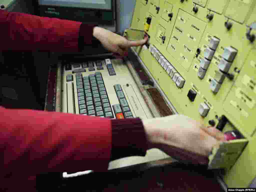 "Once the code was entered, the two officers simultaneously needed to turn a key (right), then press the launch button (left). The ""four hands"" system made it impossible for anyone to launch a missile alone, according to the museum."