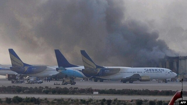 Smoke rises after militants launched an early morning assault at Jinnah International Airport in Karachi on June 9.