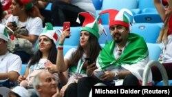 Болельщики на трибунах стадиона в Санкт-Петербурге во время матча сборных Ирана и Марокко. 15 июня 2018 года.