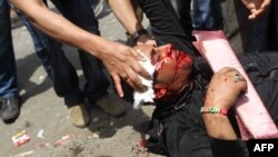 A demonstrator was wounded during clashes in the Abbassiya district of Cairo on May 2.