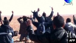 A still image broadcast on Algerian TV shows hostages surrendering to Islamist gunmen at the gas facility.
