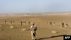 U.S. Marines on patrol with Afghan soldiers in Helmand Province in November