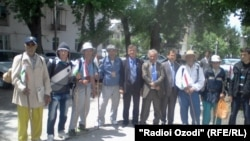 The men, along with other locals, posed for a group picture before they set off from Kulob, Tajikistan.