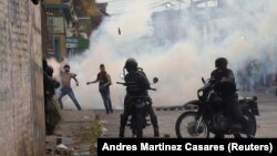 Venezuelan demonstrators clash with security forces in Urena, Venezuela.