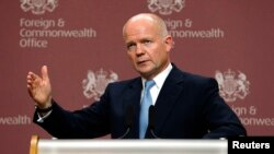 British Foreign Secretary William Hague was speaking after foreign ministers from the Friends of Syria group met with Syrian opposition leaders in London on October 22 to persuade them to attend a major peace conference in Geneva next month.