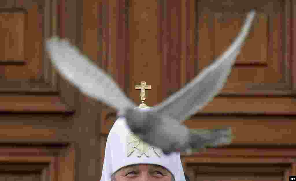Russian Patriarch Kirill releases a white dove to mark Annunciation Day in the Kremlin in Moscow, on April 7. (epa/Maksim Shipenkov)