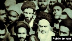 "In step with the times? A photo from the ""Khamenei.ir"" Facebook page shows current Supreme Leader Ali Khamenei (with glasses) behind Islamic Republic of Iran founder Ayatollah Ruhollah Khomeini (front with white beard)."