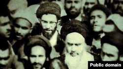 """In step with the times? A photo from the """"Khamenei.ir"""" Facebook page shows current Supreme Leader Ali Khamenei (with glasses) behind Islamic Republic of Iran founder Ayatollah Ruhollah Khomeini (front with white beard)."""
