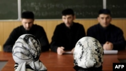 Female students in head scarves attend classes at the Grozny State Oil Institute in the capital of the Russian Caucasus region of Chechnya in March 2011.