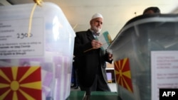 A man casts his ballot at a polling station in Skopje.