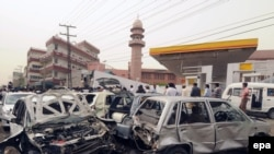 Destroyed vehicles near the site of a bomb blast at a mosque in Lahore