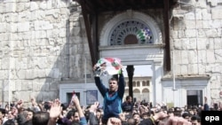 Syrians shout slogans during a pro-government rally outside the Umayyad Mosque in the old city of Damascus on March 25.