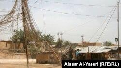 أسلاك تجهيز الكهرباء من مولدة في حي ببغداد