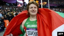 Belarus's Nadzeya Ostapchuk celebrates after winning the women's shot-put final in London on August 6.