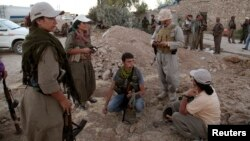 PKK fighters deploy against Islamic State militants on the front line in Makhmur in Iraq's Kurdish region iin August.