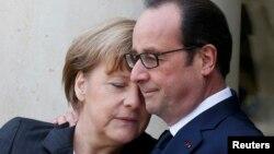 Миротворцы? Ангела Меркель и Франсуа Олланд