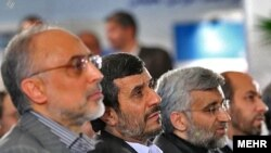 Iran's chief nuclear negotiator, Said Jalili (second from right), next to President Mahmud Ahmadinejad (second from left)