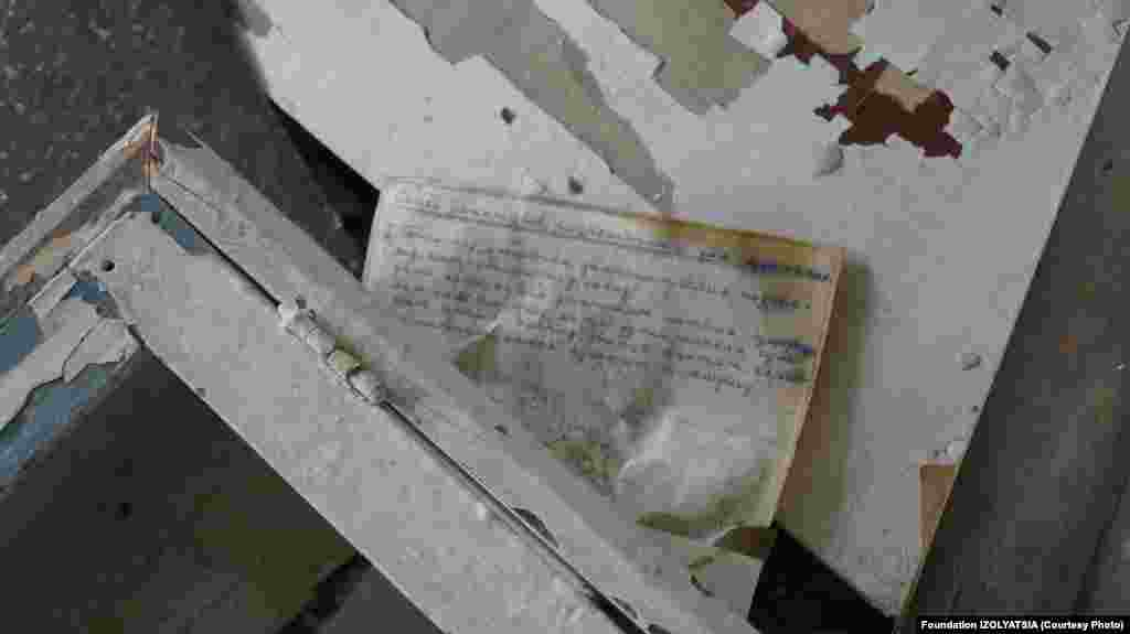 A letter left inside a damaged home