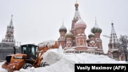 A bulldozer shovels snow off Red Square as snow falls in Moscow on February 4.
