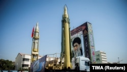 IRAN -- A display featuring missiles and a portrait of Iran's Supreme Leader Ayatollah Ali Khamenei is seen at Baharestan Square in Tehran, September 27, 2017