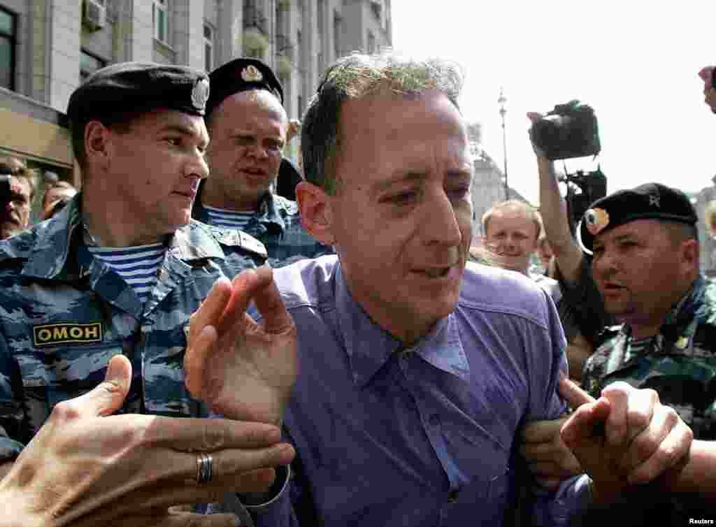 Tatchell, moments after the punch, being detained by Russian police. The images of nonviolent protesters being attacked with near impunity ushered in a new era in Russia. Far right groups and Orthodox Christian extremists seemed to have been given carte blanche for violence against gay activists.