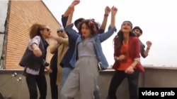 "A still photo from the Iranian ""Happy"" video"