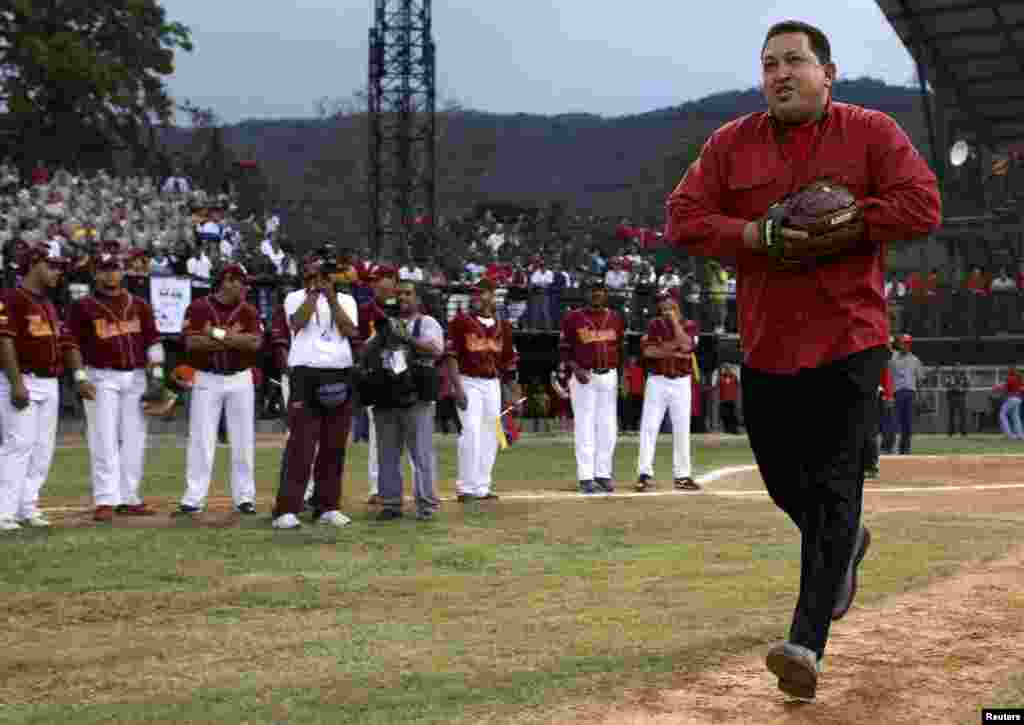 Chavez prepares to deliver the first pitch during a baseball game in Caracas in May 2007.